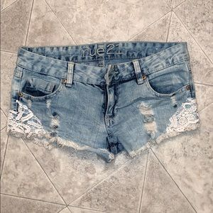 Rue21 light wash jean shorts with lace sides